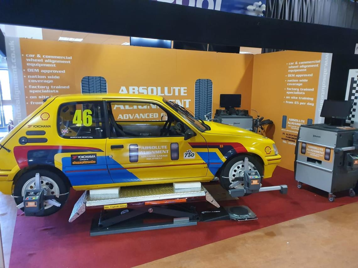 Peugeot 205 race car undergoing four wheel alignment